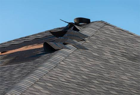 Uplifted shingles from storm damage